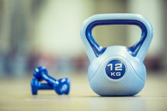 Kettlebel. kettlebell in gym on floor. Toned image.  Stock Photography