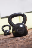 Kettlebell. Two kettlebell, one big and one small in the background, on the carpet Stock Image