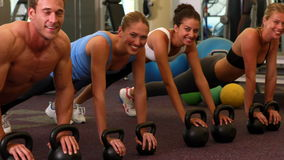 Kettlebell class getting into plank position Royalty Free Stock Image
