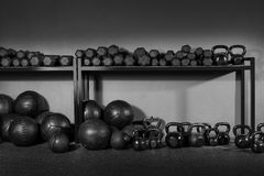 Kettlebell and dumbbell weight training gym. Kettlebells dumbbells and weighted slam balls weight training equipment at gym Royalty Free Stock Images