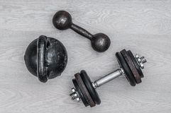 Kettlebell and dumbbells on wooden background royalty free stock images