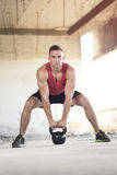 Kettlebell lifting Stock Photography