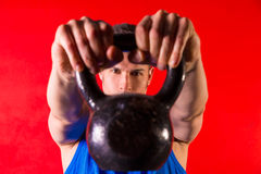 Kettlebell man portrait looking through the handle Royalty Free Stock Photography