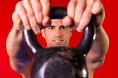 Kettlebell man portrait looking through the handle Royalty Free Stock Photo