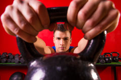 Kettlebell man portrait looking through the handle Stock Photos