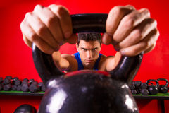 Kettlebell man portrait looking through the handle Royalty Free Stock Image
