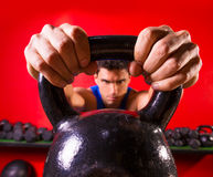 Kettlebell man portrait looking through the handle Royalty Free Stock Photos