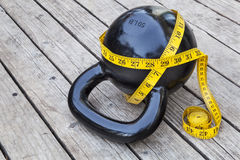 Kettlebell and measuring tape Stock Image