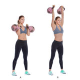 Kettlebell military press. Athletic woman performing a functional exercise with kettlebell stock photo