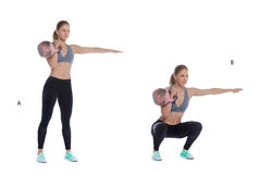 Kettlebell one arm front squat Stock Images
