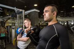 Kettlebell swing training of two young men in the gym Royalty Free Stock Photography