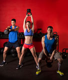 Kettlebell swing workout training group at gym Stock Images