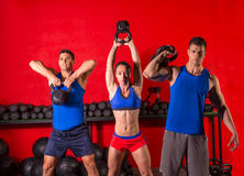 Kettlebell swing workout training group at gym. With red wall Royalty Free Stock Photos