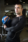 Kettlebell swing workout training man at gym. Royalty Free Stock Photo