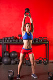 Kettlebell swing workout training woman at gym Royalty Free Stock Images
