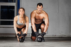 Kettlebell training man and woman Royalty Free Stock Photos