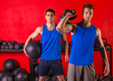 Kettlebell and weighted ball workout gym men Royalty Free Stock Photography