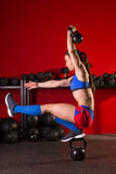 Kettlebell woman pistol squat  balance at gym Stock Photos