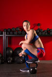Kettlebell woman relax after workout in red gym Royalty Free Stock Photography