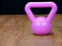 Kettlebell on a wooden floor royalty free stock image