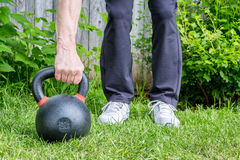 Kettlebell workout in backyard Royalty Free Stock Images