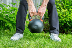 Kettlebell workout in backyard Royalty Free Stock Image