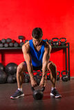 Kettlebell workout training man at gym Stock Image