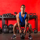 Kettlebell workout training man at gym Stock Photos