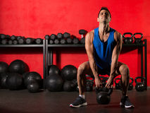 Kettlebell workout training man at gym. Kettlebell swing workout training man at gym with red walls Stock Photography