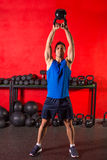 Kettlebell workout training man at gym Stock Photo