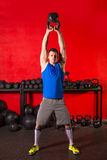 Kettlebell workout training man at gym Stock Images