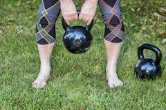 Kettlebells - backyard fitness Royalty Free Stock Photos