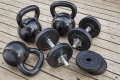 Kettlebells and dumbbells Stock Images