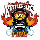 Kettlebells en el fuego Imagen de archivo libre de regalías