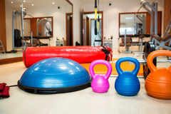 Kettlebells at fitness gym Stock Images