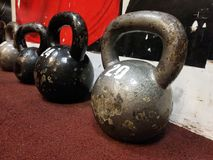 Kettlebells on flor. Old gray and black kettlebells on flor in gym royalty free stock photography