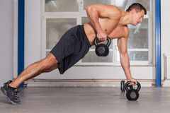 Kettlebells pull up crossfit fitness training Stock Images