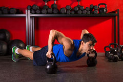 Kettlebells push-up man strength gym workout Stock Photos