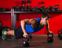 Kettlebells push-up man strength gym workout Royalty Free Stock Photos