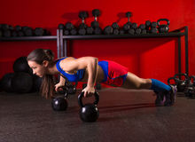 Kettlebells push-up woman strength gym workout Stock Photography