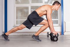 Kettlebells training crossfit - man in a gym Stock Photography
