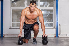 Kettlebells training crossfit - man in a gym Stock Photos