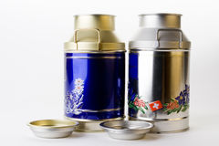 Kettles. Decorated milk tin plate kettles on white bottom Royalty Free Stock Photos