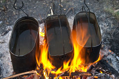 Kettles in fire Royalty Free Stock Images
