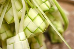 Ketupat casing and rice in bamboo container. traditional malay d. Elicacy during Malaysian eid festival Royalty Free Stock Image