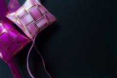 Gold purple ribbons of ketupat.close up