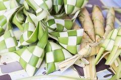 Ketupat, dumpling made of woven palm leaf stuffed with rice