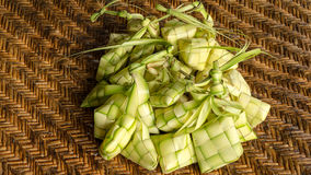Ketupat. Kupat or Tipat is a type of dumpling made from rice packed inside a diamond-shaped container of woven palm leaf pouch. It is commonly found in Royalty Free Stock Photography