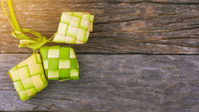Ketupat, a natural rice casing made from young coconut leaves for cooking rice.. Ketupat rice dumpling is a local delicacy during the festive season in South stock photo