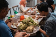 Ketupat with people eating on the background